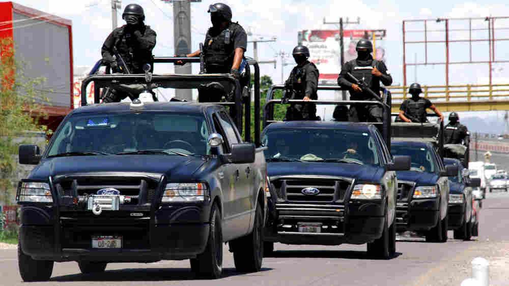 Police officers patrol a street in Torreon