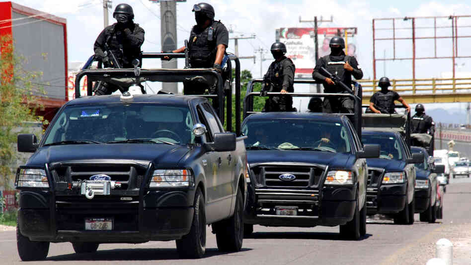 Police officers patrol a street in Torreon