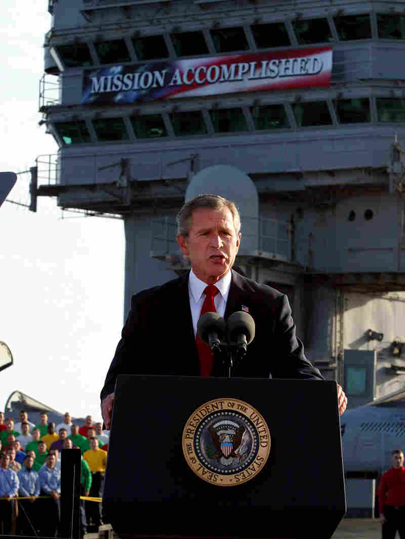 """President Bush announces """"mission accomplished"""" in Iraq on the USS Abraham Lincoln in 2003"""
