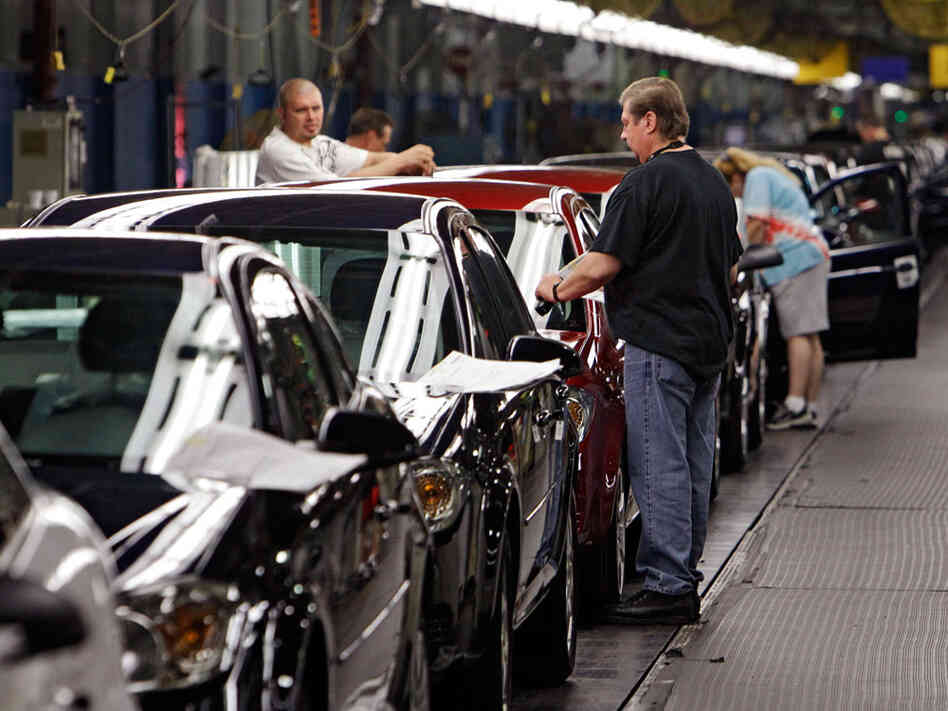 Workers at GM's assembly plant in Lordstown, Ohio, put the final touches on 2011 Chevrolet Cobalts.