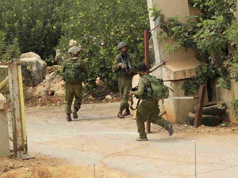 Israeli soldiers secure the area near the border with Lebanon on Wednesday.