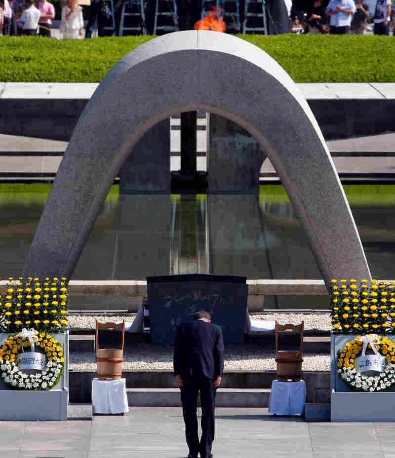 U.N. Secretary-General Ban Ki-moon bows in front of the cenotaph in Hiroshima's Peace Memorial Park.