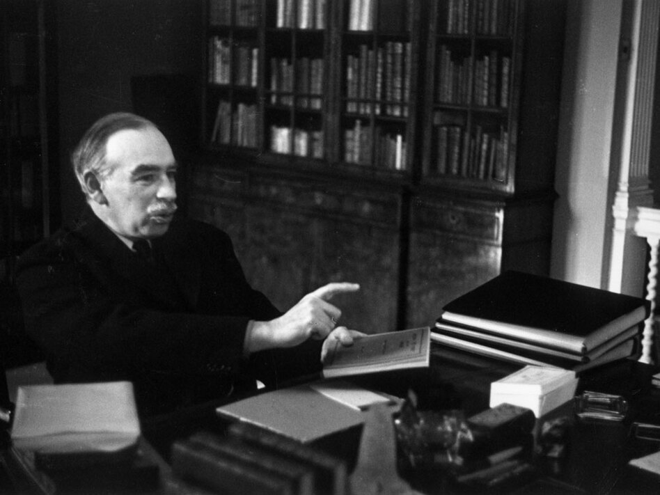 John Maynard Keynes, considered the father of modern macroeconomics, sits at his desk in London in 1940. Economists call the Obama administration's stimulus package the first real test of Keynesian economics, but long-term benefits of Keynes' theory are still up for debate.