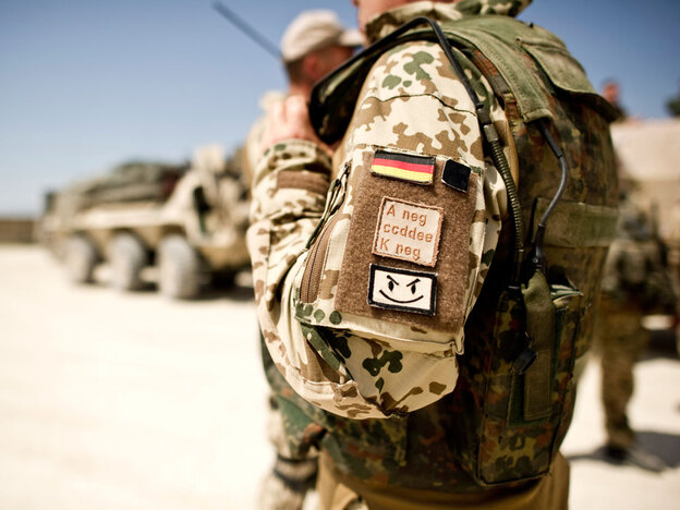 A German soldier prepares to depart on a multiday patrol in Kunduz, Afghanistan, in May. In northern Afghanistan, incoming U.S. troops are officially under German command.