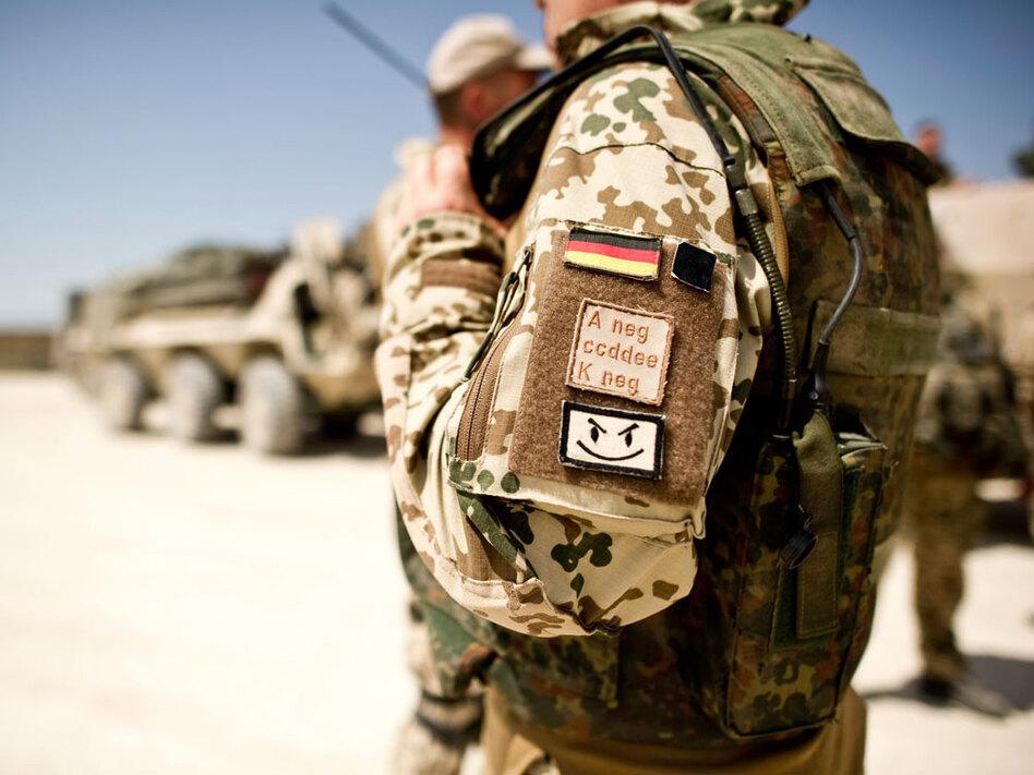 A German soldier prepares to depart on a multiday patrol in Kunduz, Afghanistan, in May. In northern Afghanistan, incoming U.S. troops are officially under German command.