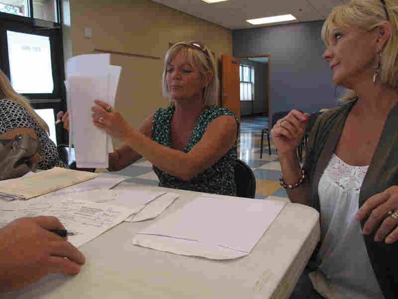 Twin sisters Sheila Newman and Sheryl Lindsay make their case to a BP claims adjuster.