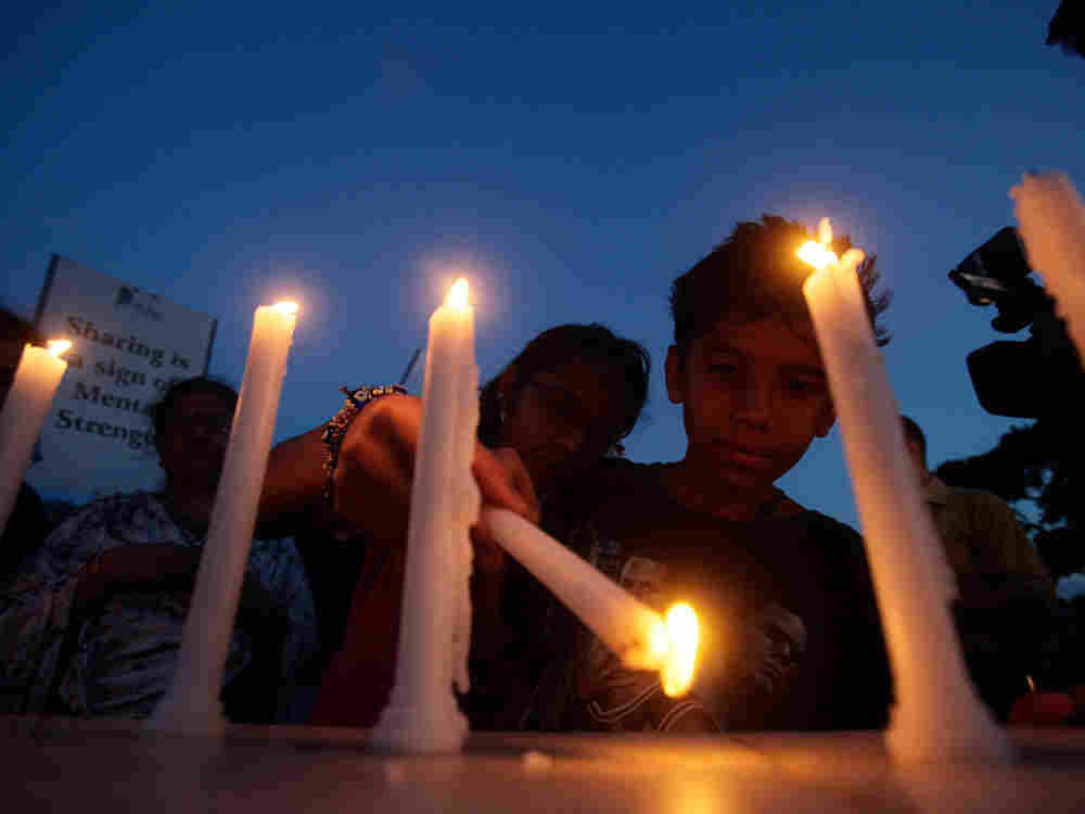 Children light candles in India
