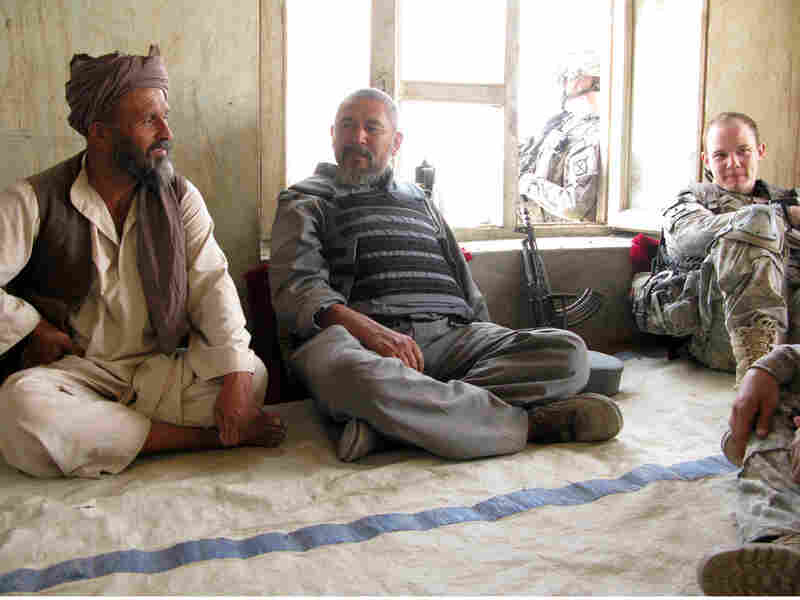 U.S. Army Lt. Mike Kehoe sits down for a chat with a village elder and the local police chief.