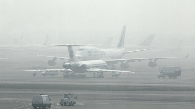 Passenger planes are seen blanketed by forest fire smog