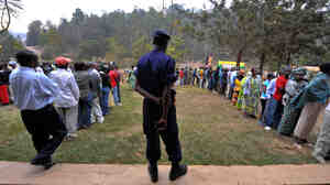 Voters in line Monday outside a polling station in Kigali