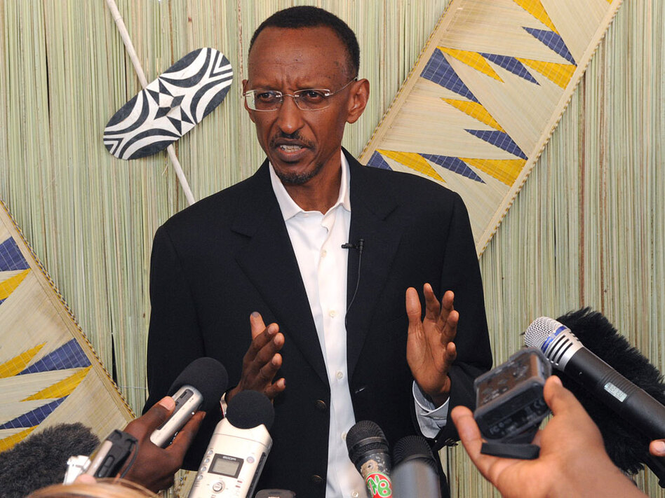 Rwanda's President Paul Kagame speaks to journalists after casting his vote Monday.
