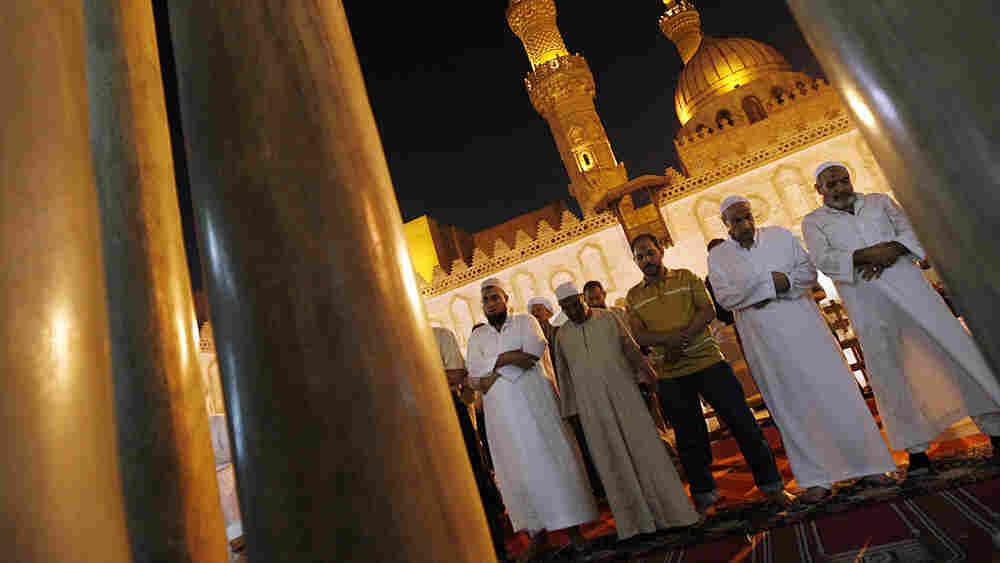 Muslim Egyptian men pray during Ramadan in 2009