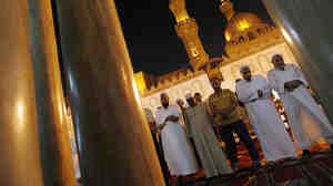 Muslim Egyptian men pray during Ramadan in 2009