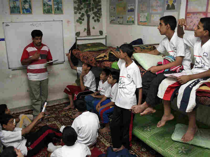 Iraqi social worker teachers orphans in Baghdad's Sadr City