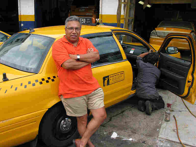 Jose Guevara, a cab driver for 30 years, leans on his trusty Crown Victoria.