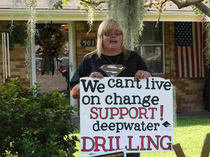 Jeanette Tanguis of Houma, La., holds a poster supporting deep-water drilling.