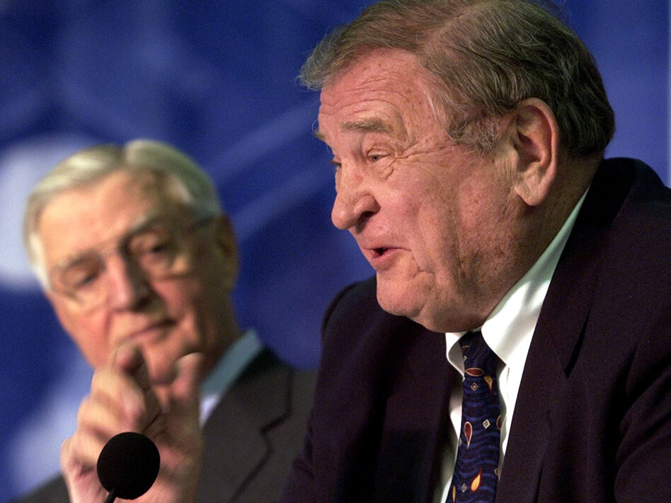 Former U.S. Rep. Dan Rostenkowski talks about the late Chicago Mayor Richard J. Daley at a 2005 celebration honoring the 50th anniversary of Daley's debut as mayor. In the background is former Vice President Walter Mondale. Rostenkowski, like Daley a towering political figure from the Windy City, died Wednesday at age 82. (Charles Rex Arbogast/AP)
