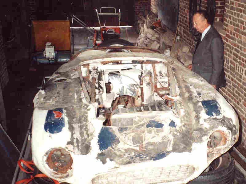 Jacques Swaters looks over the shell of the car when he bought it in 1990.