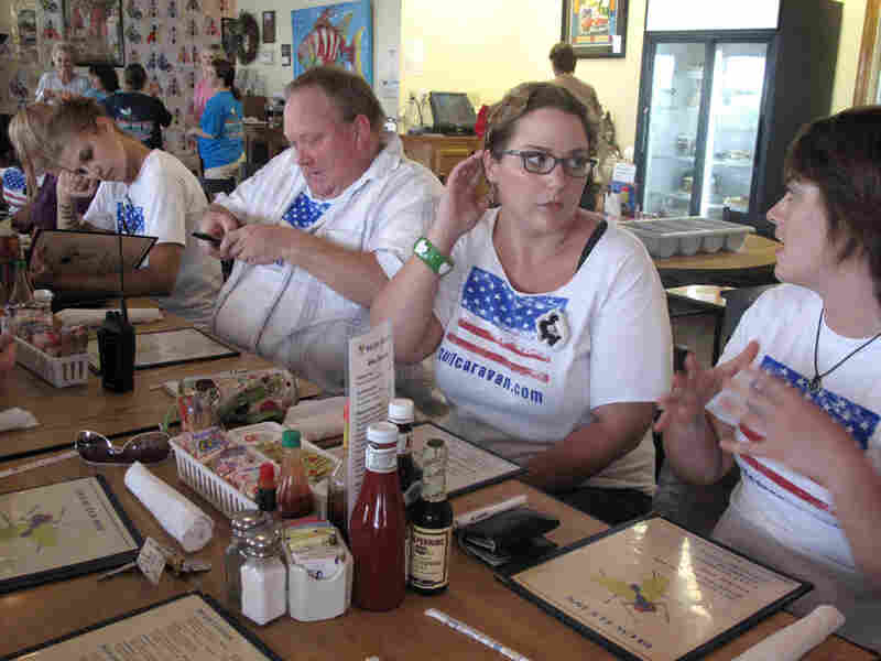 Members of the Gulf Caravan sit down to breakfast at the Blow Fly Inn in Gulfport, Miss.