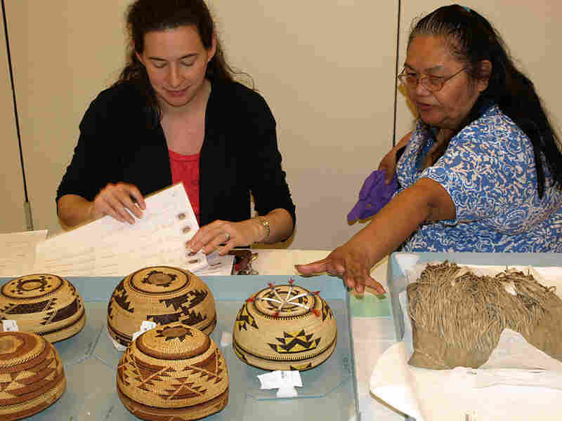 Rebecca James (right) talks with National Museum of the American Indian's Cara Fama about baskets.