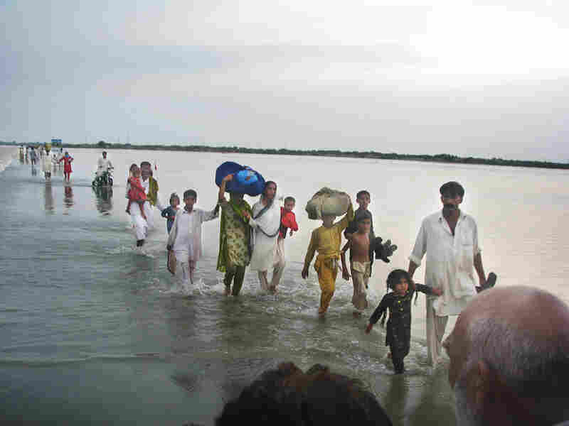 Families in southern Punjab province seek higher ground from the rising Indus River.