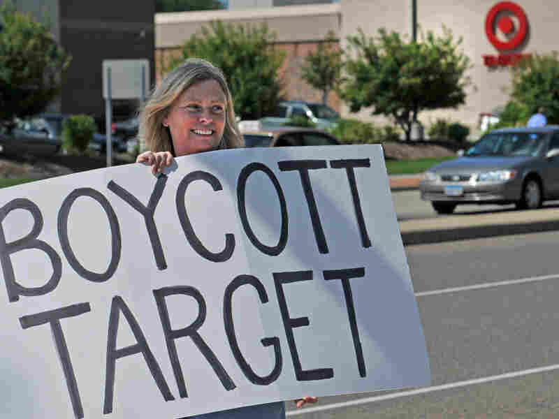 Laura Hedlund, 48, protests in front of a Minnesota Target store.