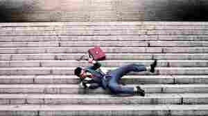 A man falls down steps.