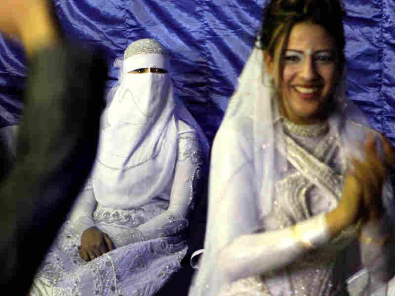 In Cairo, a Muslim bride (left) wearing a full veil.