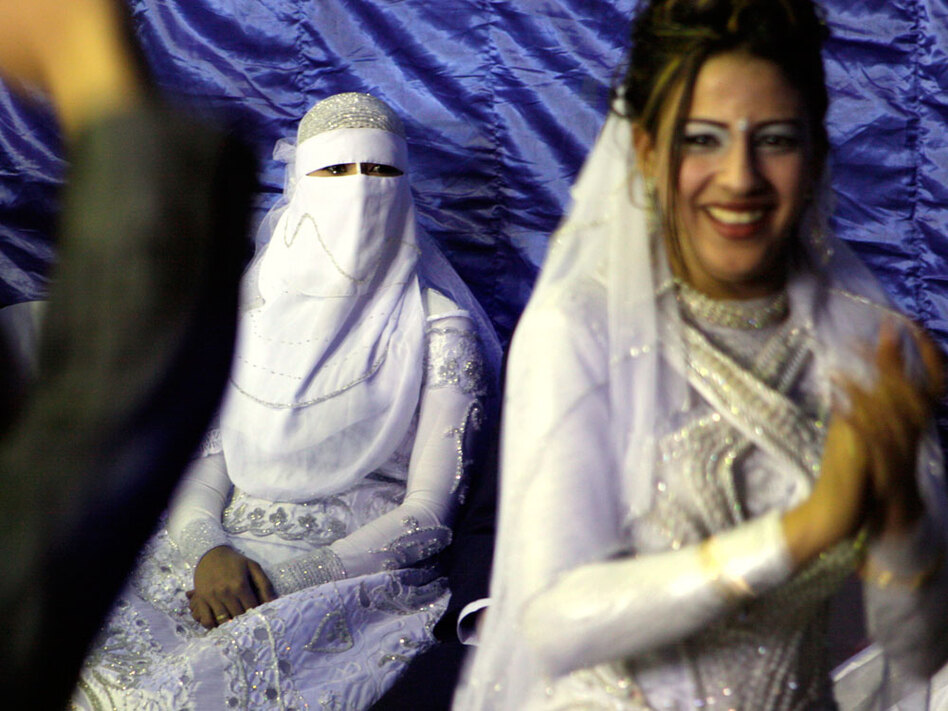 In Cairo, a Muslim bride (left) wearing a full veil.