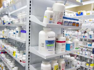 Bottles of drugs fill shelves at the storeroom of Kohll's Pharmacy & Homecare in Omaha, Neb.