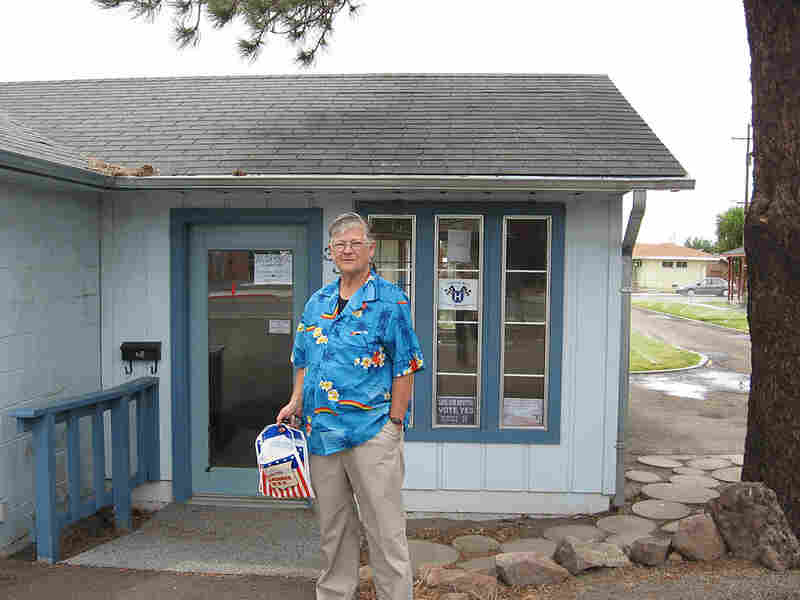 Lau Miller stands outside the Save Our Hospital committee headquarters in Alturas, Calif.