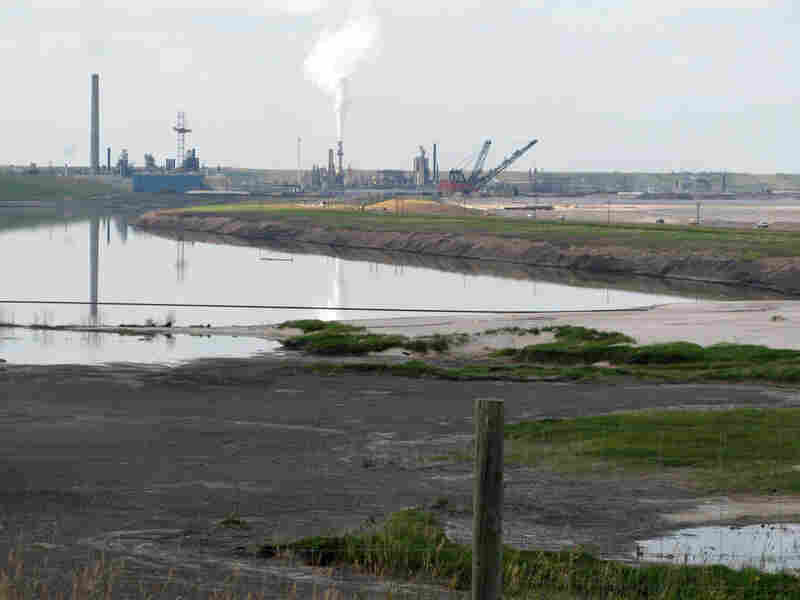 A tailings pond next to an upgrading facility for an old pit mine, in Alberta, Canada.