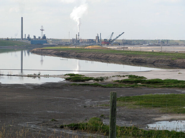 A tailings pond next to an upgrading facility for an old pit mine in Alberta, Canada.