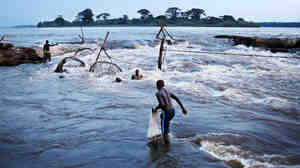 A fisherman prepares to cast a net into th
