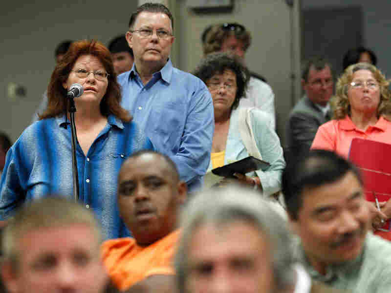 Residents line up to ask questions of independent claims administrator Kenneth Feinberg.