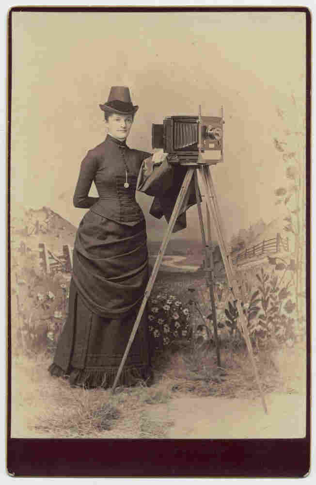 Woman with camera, 1880