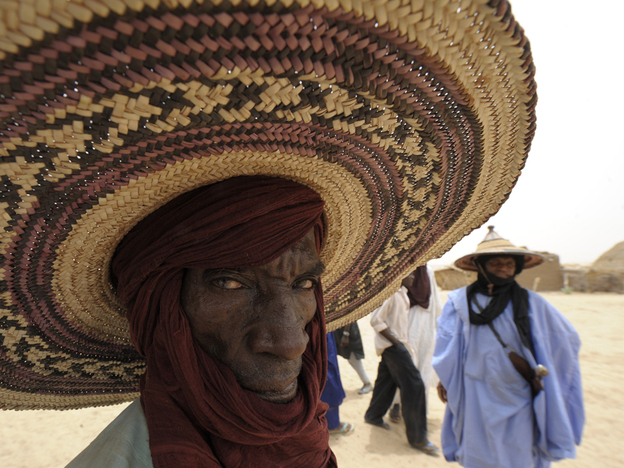 A farmer waits for food distribution near Dakoro, in northern Niger, in May. U.N. agencies sounded alarms back in November about a growing food crisis in the West African nation, one of the world's poorest. Now more than 8 million people in Niger are in desperate need of aid.