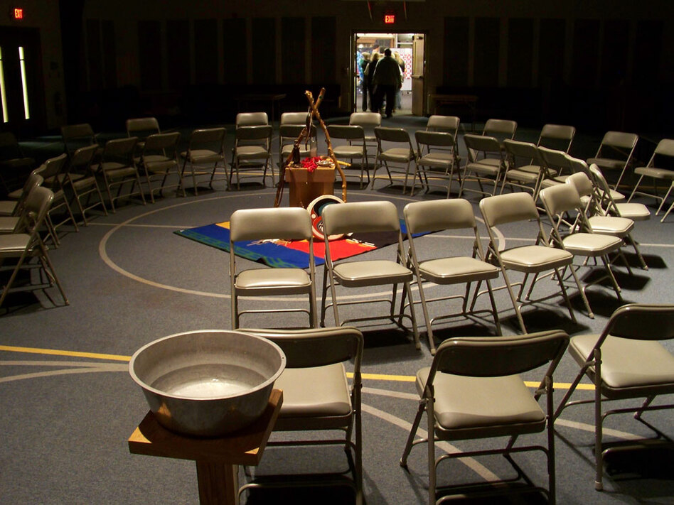 Participants leave a healing ceremony offered by the veterans' group Warrior's Journey Home near Akron, Ohio. During the ceremony, veterans sit on the inner circle of chairs, the civilians on the outer circle facing them. The bowl (lower left) holds water for the ritual washing of hands.