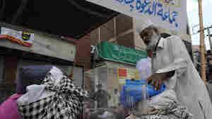 Man donates clothes for Pakistan flood victims