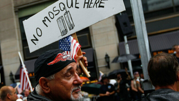 An opponent of an Islamic cultural center and mosque planned near ground zero in Lower Manhattan holds a sign during a demonstration Sunday in New York. Activists both for and against the proposed Park51 project rallied supporters near the proposed building site. (Getty Images)
