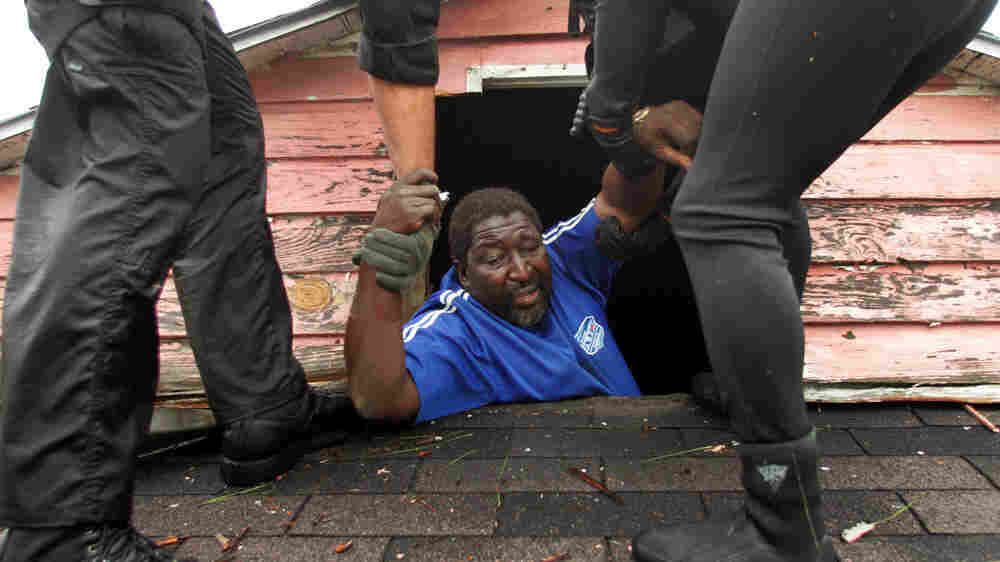 A man is rescued from his roof in New Orleans after Hurricane Katrina.