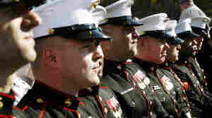 U.S. Marines wait for the dedication ceremony of the National Museum of the Marine Corps.