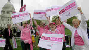 Breast cancer survivors from the Pink Ladies of Charles County, Md., dance at a Capitol Hill rally.