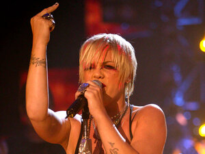 """Singer Pink """"flips the bird"""" during a 2003 concert in London."""