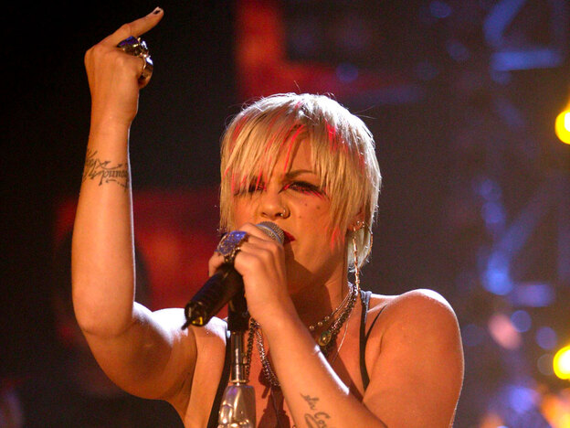 Pink lets her bird fly during a concert in London.