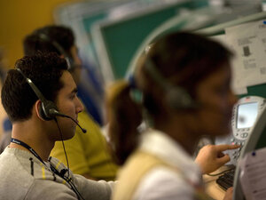 Indian workers answer telephone calls at a call center on the outskirts of New Delhi