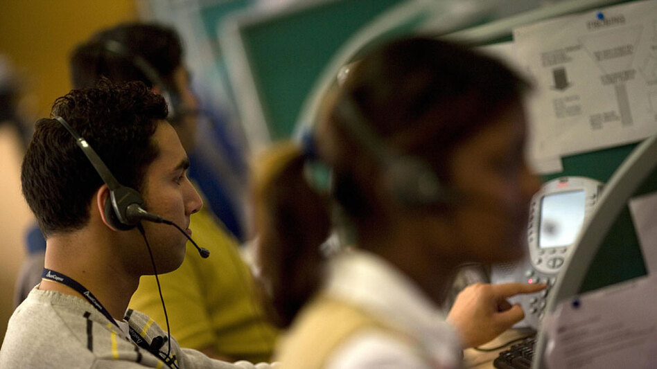 Indian workers answer telephone calls at a call center on the outskirts of New Delhi in 2008. Increasingly, American companies are employing U.S. workers to handle customer service calls in their own homes.