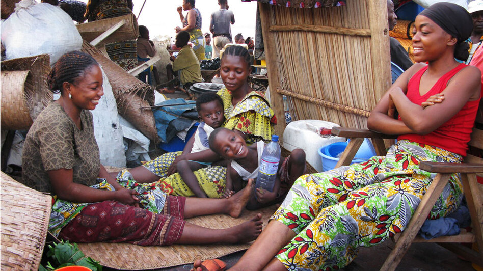 Women and children relax on the M/B SETB barge sailing along the Congo River.