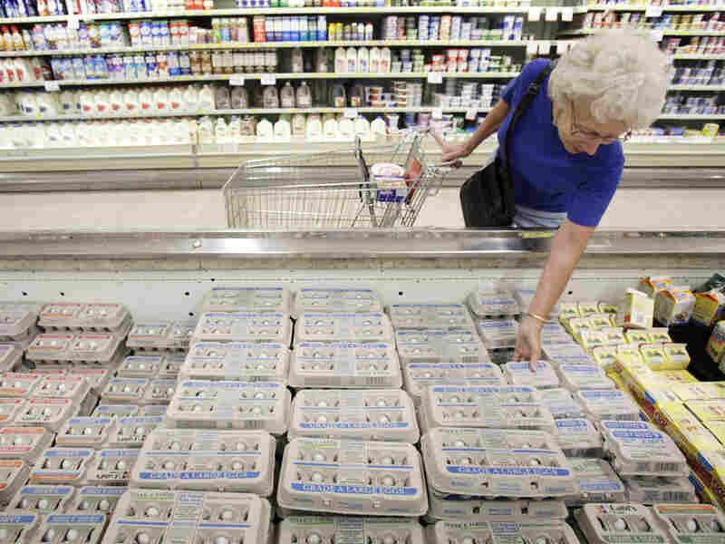 Janet Weaver, of Des Moines, Iowa, shops for eggs at a Dahl's supermarket on Aug. 23.