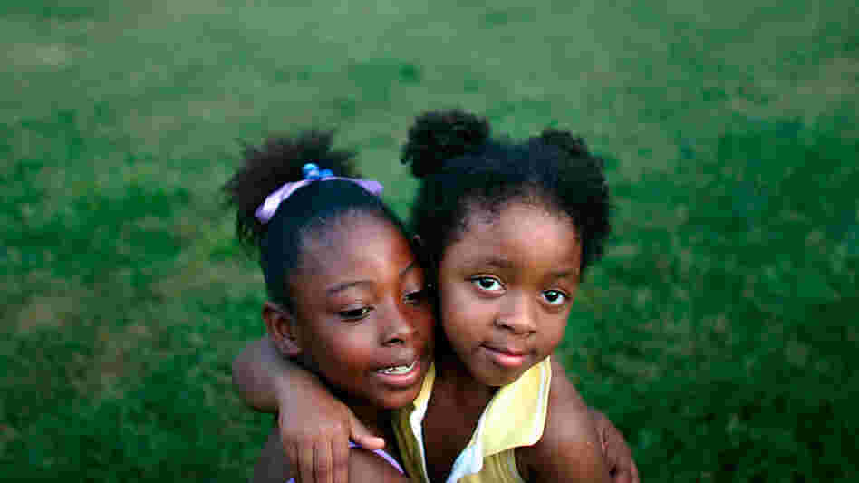Two girls are seen at a housing project in New Orleans in 2007.